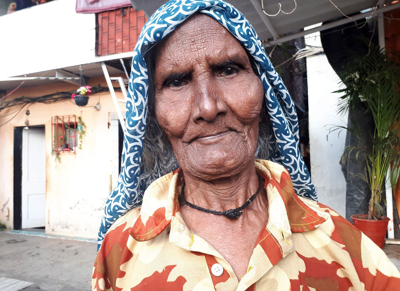 Bhateri Devi standing outside