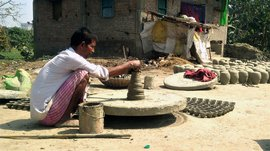 Firing the last of the pots in Rasulpur Sohawan
