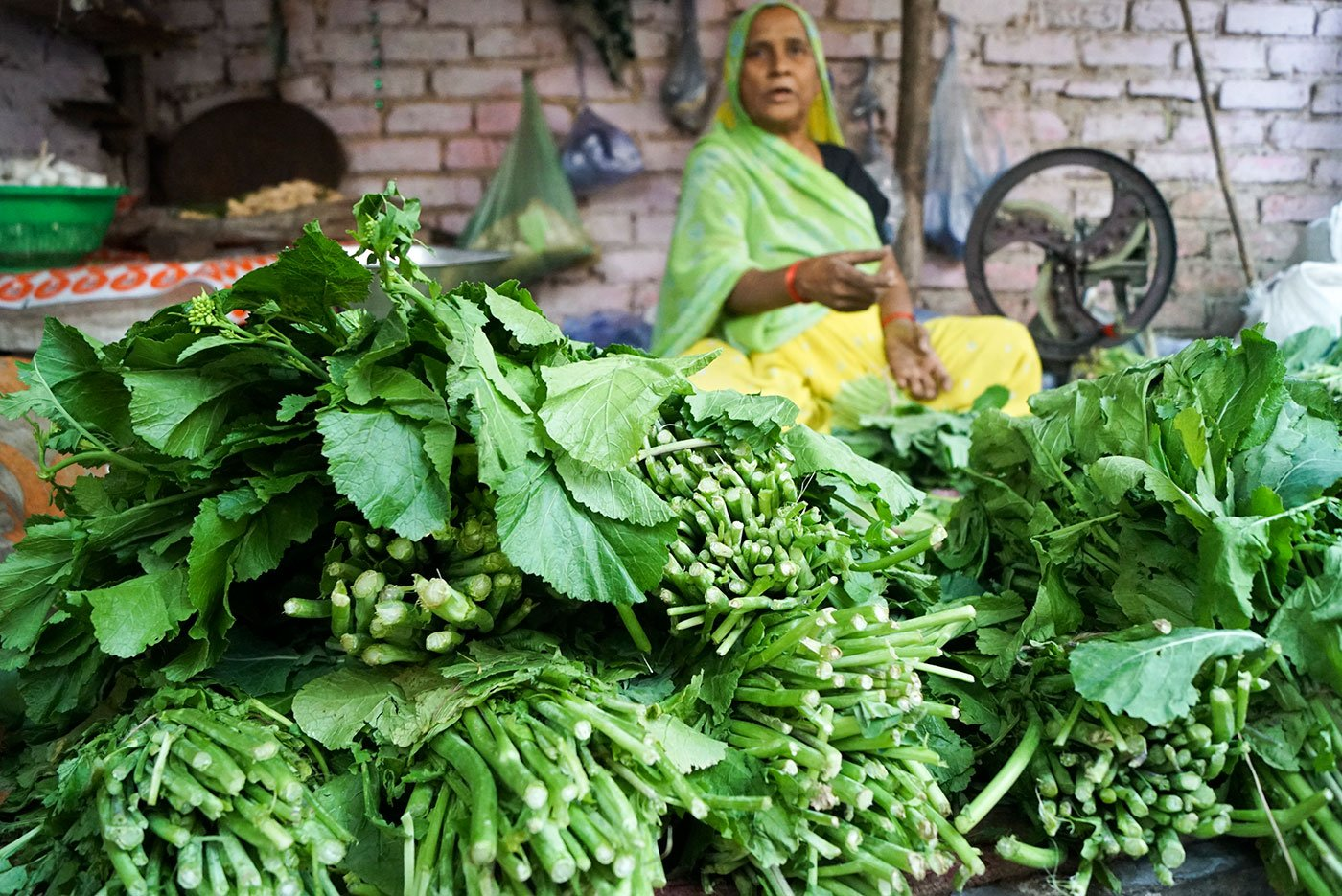 A women selling vegetables in the Delhi market