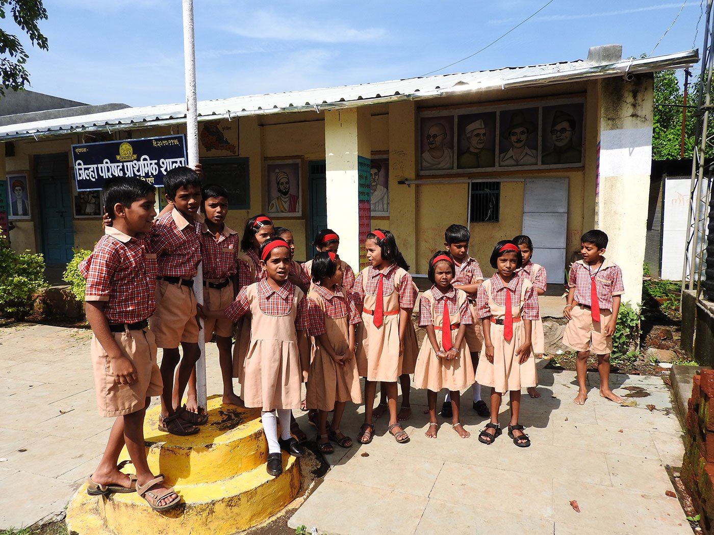 Children singing outside a school.