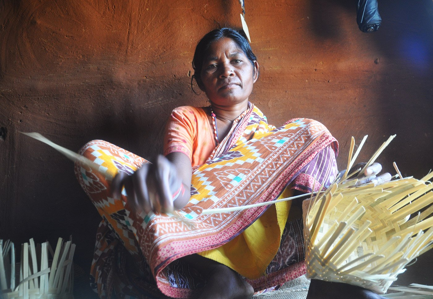 Kamla Paharia weaving baskets