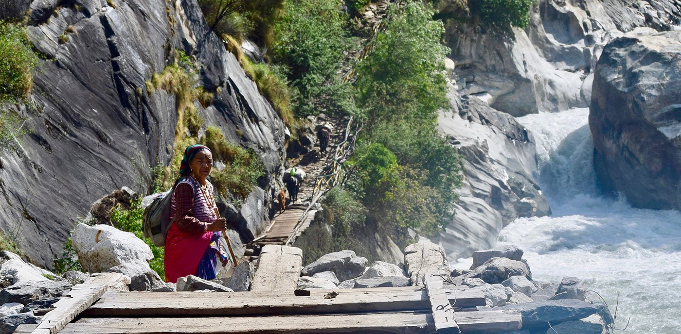 Sukhmati Devi on the walking route, which is also the mule route, includes steep climbs and temporary bridges over the high-current Kali River