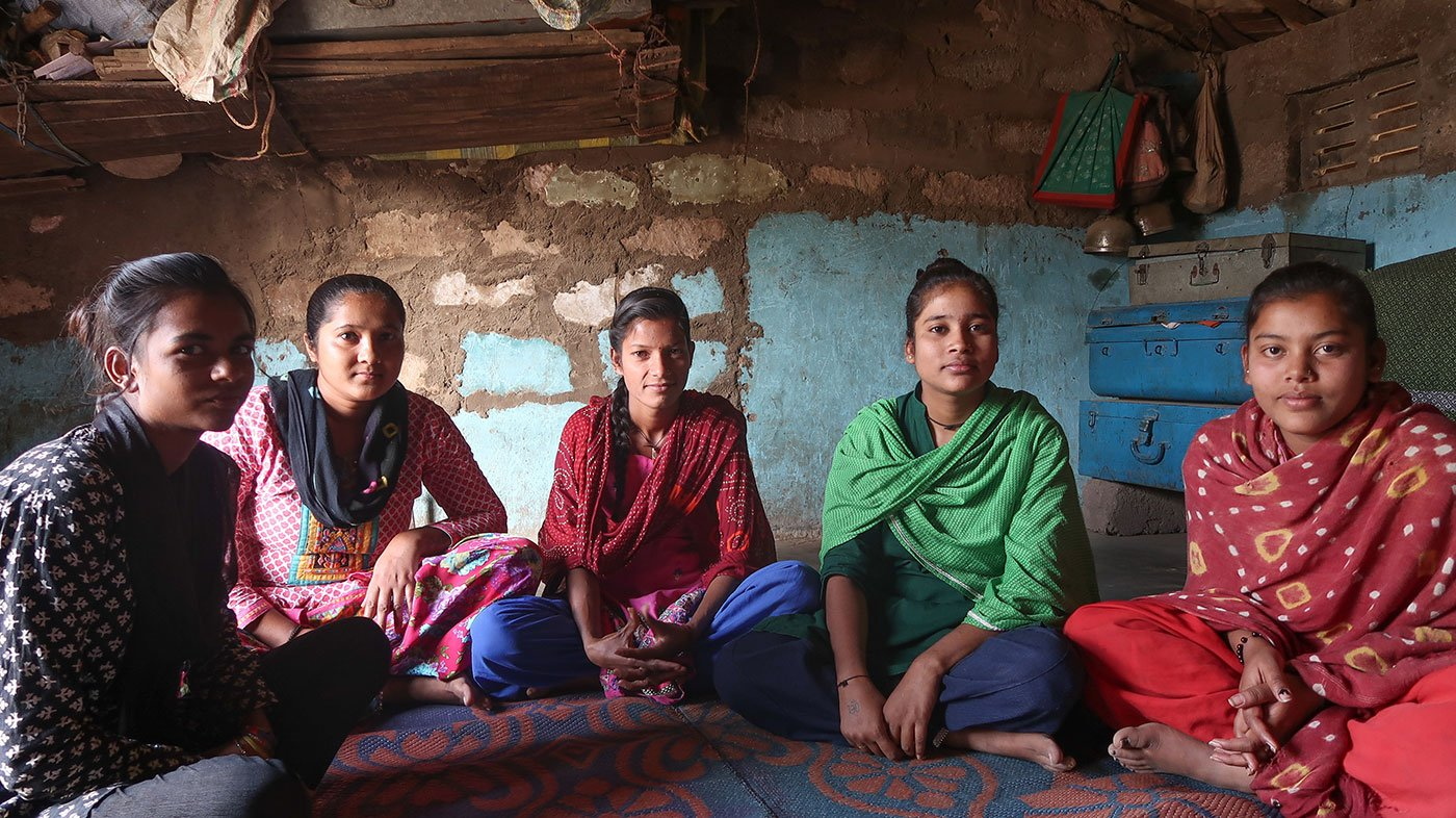 Young women sitting in a house speak of their hopes and doubts about elections