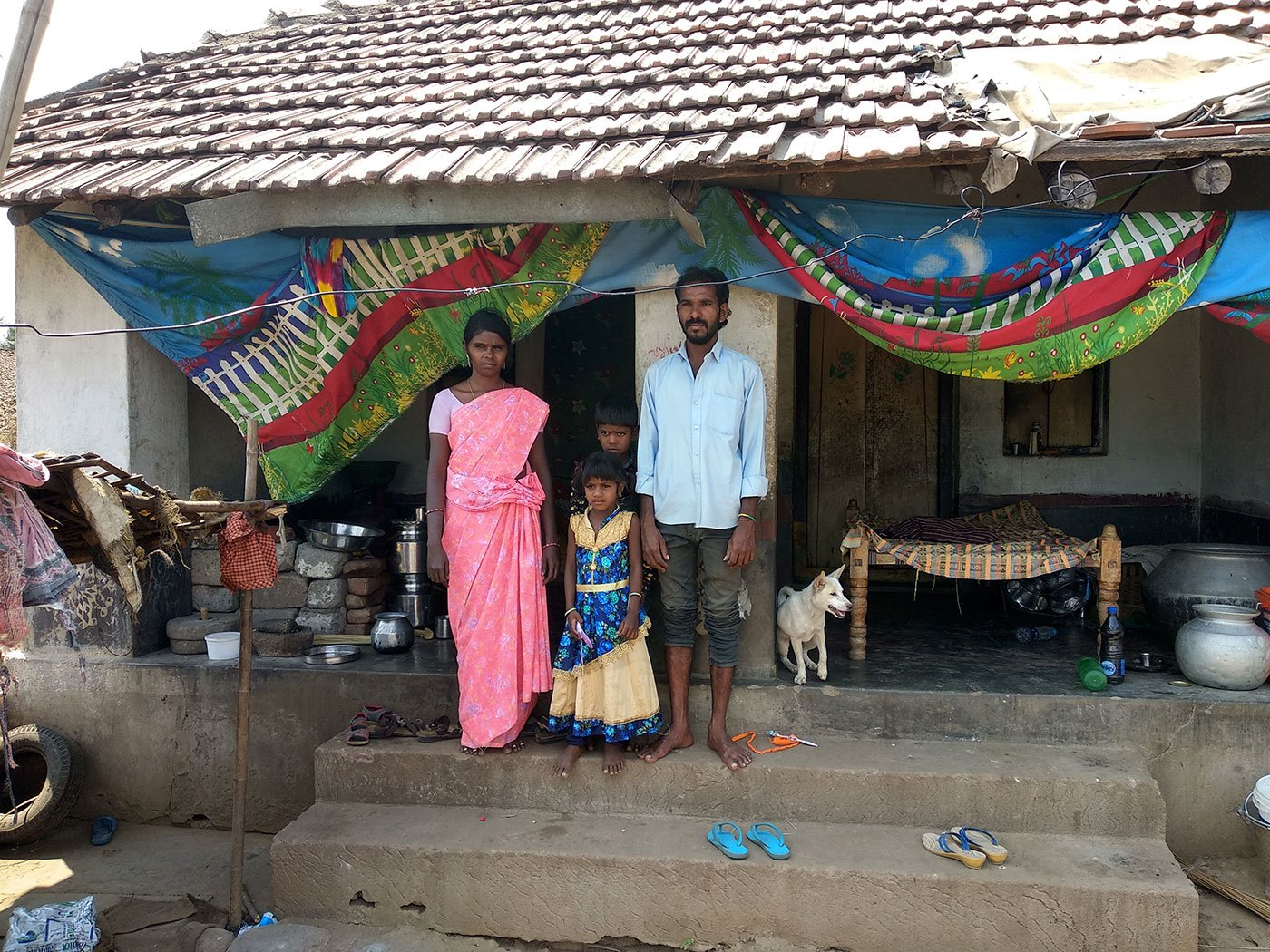 Sridevi, Smiley, Prashanth and Suryachandram, in front of their house in Pydipaka