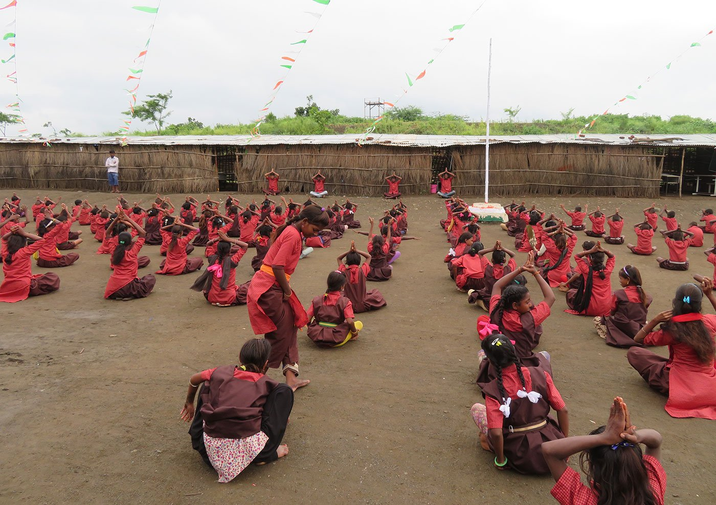 Students of Phanse Pardhi School exercising on the school grounds