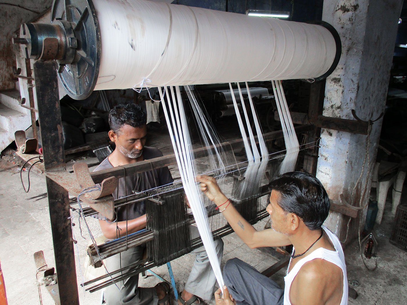 Workers toil on the beem-pachaad (rolling pin) machine in a unit on Ved Road. The workers earn a daily wage of Rs 250-Rs 300 after toiling for 12 hours