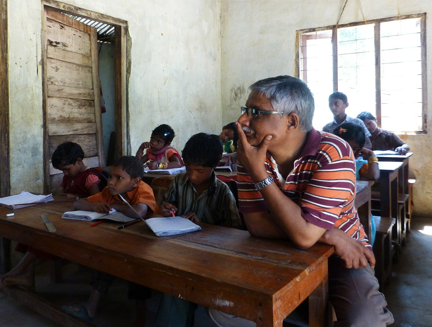 classroom full of boy students narrating poem