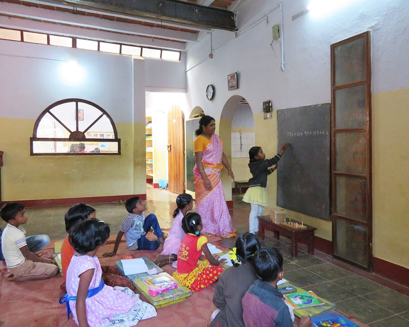 Shanthi Kunjan teaching her class in school