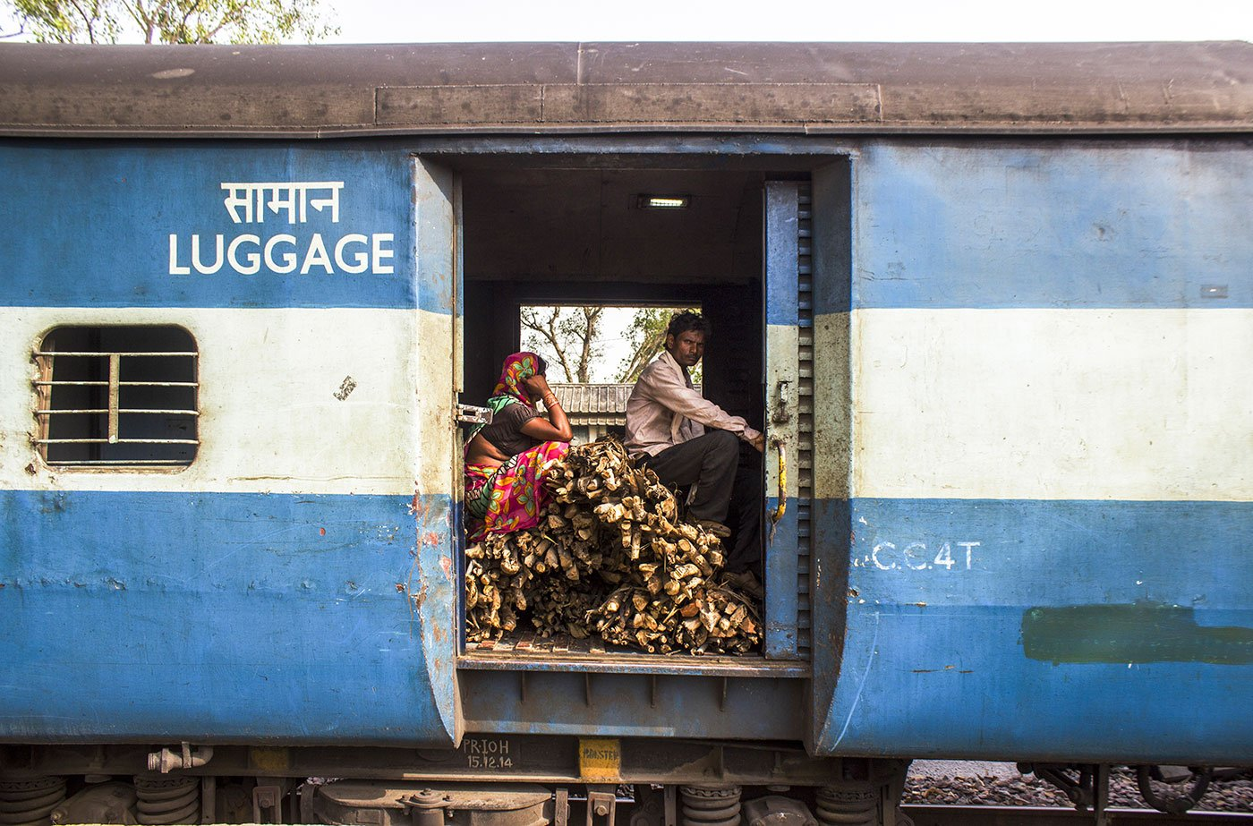 An Adivasi couple travelling with their firewood