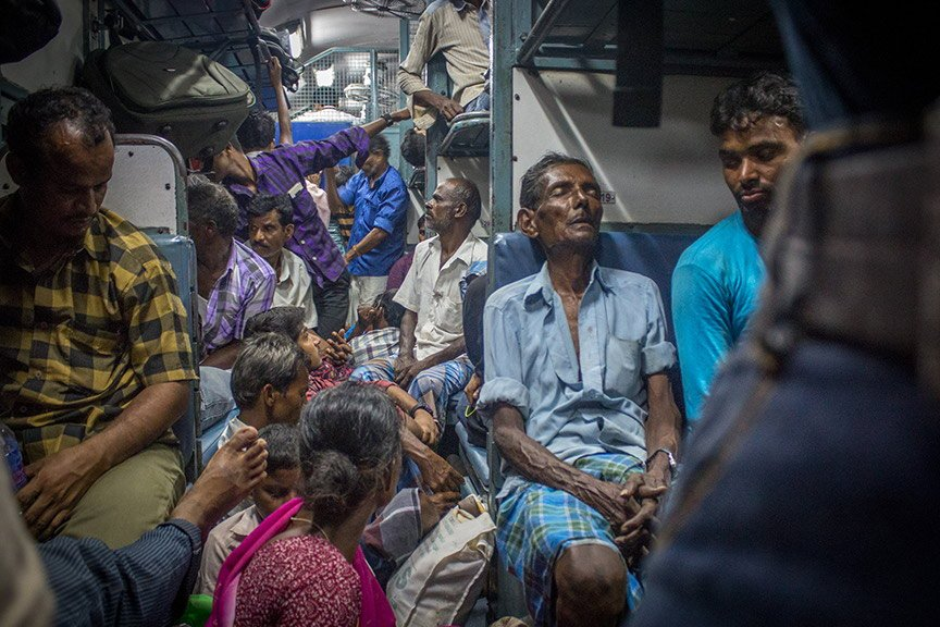 Exhausted migrants on the Kochi-Kadiri train