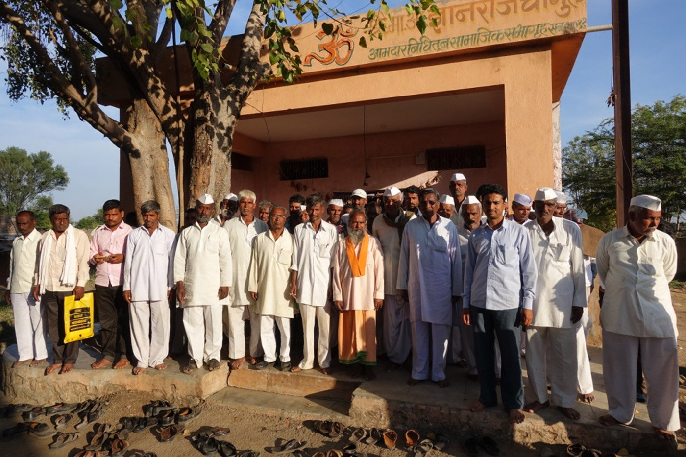 Farmers standing in front of Osamabad District Central Operative Bank
