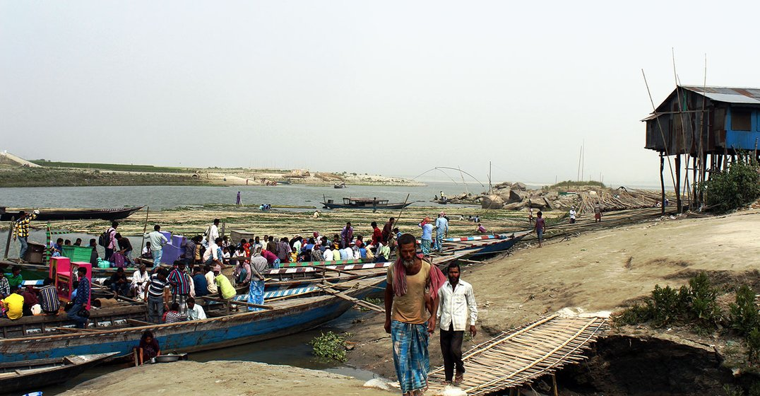 Workers arriving from the different islands on the Brahmaputra river to work in Dhubri town.