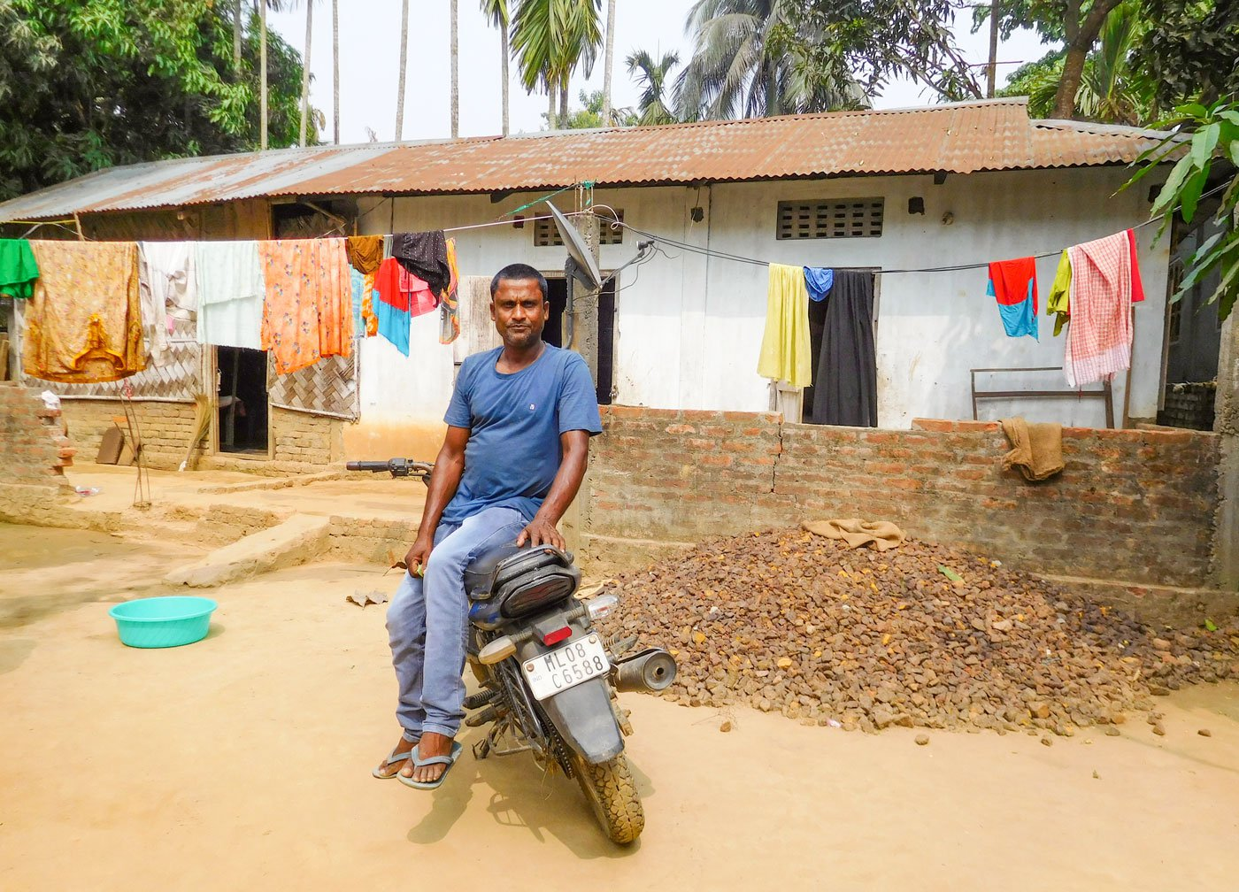 Anarul Islam in front of his house in South West Garo Hills: 'My ancestors lived here, what is now the international border'