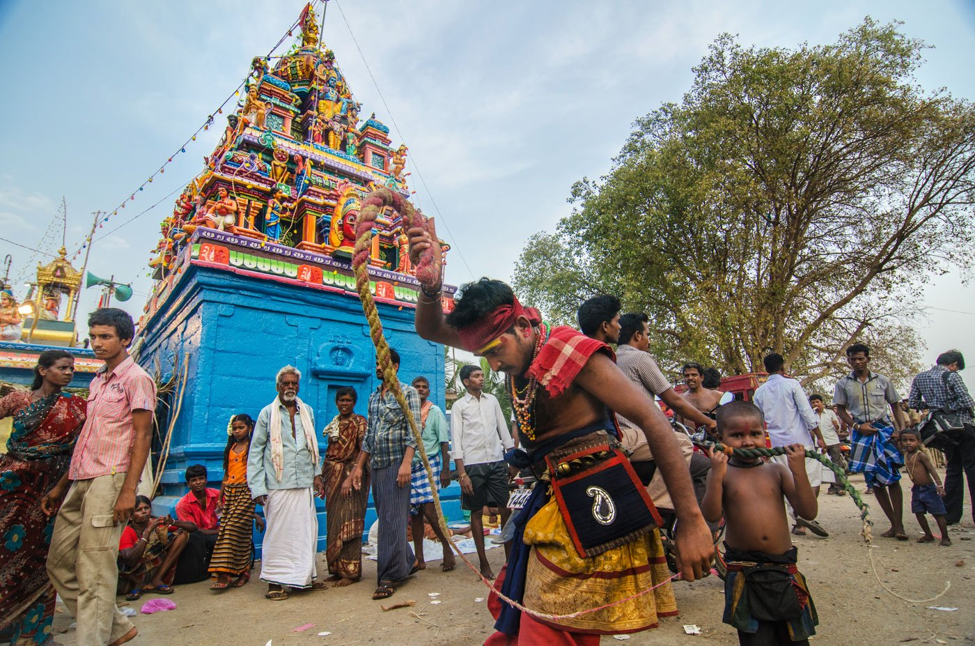 The temple dedicated to Lord Aravan (known locally as Koothandavar) is in Koovagam village, about 30-40 kilometres from Viluppuram town in Tamil Nadu. A man whipping himself in front of a temple.