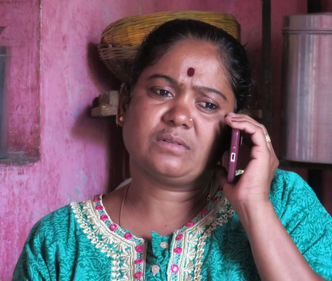 Sunita listening to a case over the phone