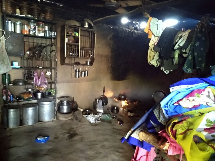 The inside of a hut with utensils and clothes