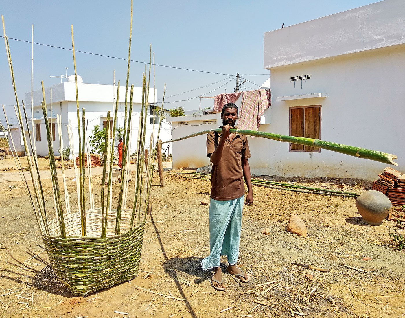 Praveen Kumar works as an agricultural labourer. He goes to the nearby forests and pick up bamboo sticks and make baskets. He takes three days to make one such basket – one day for getting the bamboo from the forests and two for making the basket. He needs three bamboo sticks, of the size he is holding, to make one basket