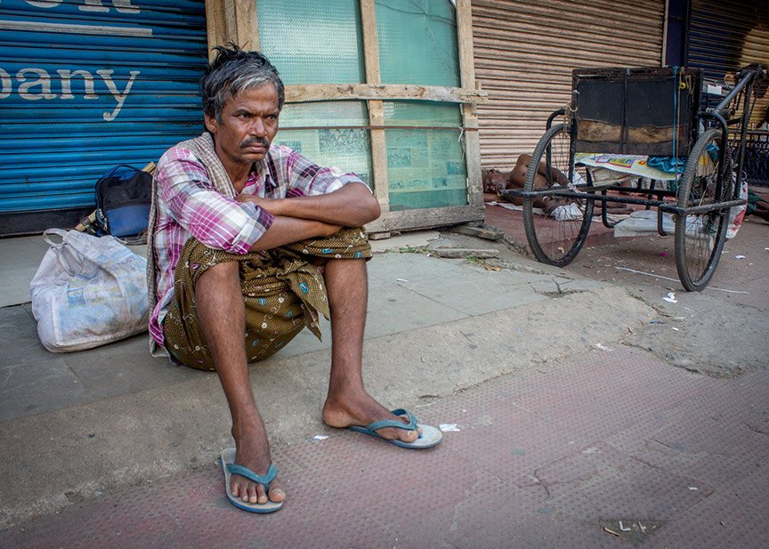A migrant labourer with no work on a Sunday