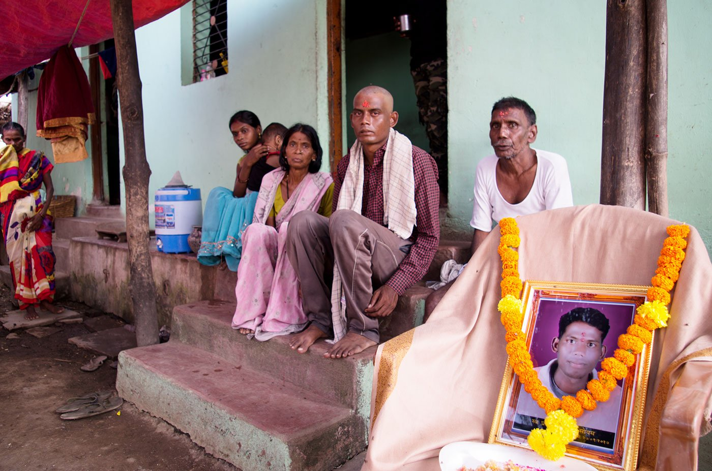 Namdev Soyam, with his parents, Bhaurao and Babybai, mourning the death of his younger brother, Pravin, at their home in village Tembhi of Yavatmal in September 2017