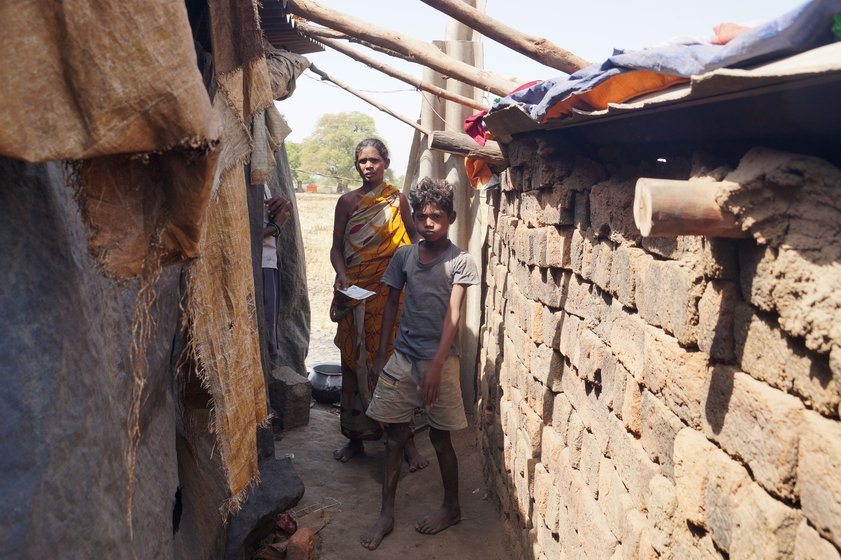Left: Kuni Tamalia and son Jagannadh near their small home made with loosely stacked bricks. Right: Sumitra Pradhan, Gopal Raut and daughter Rinki