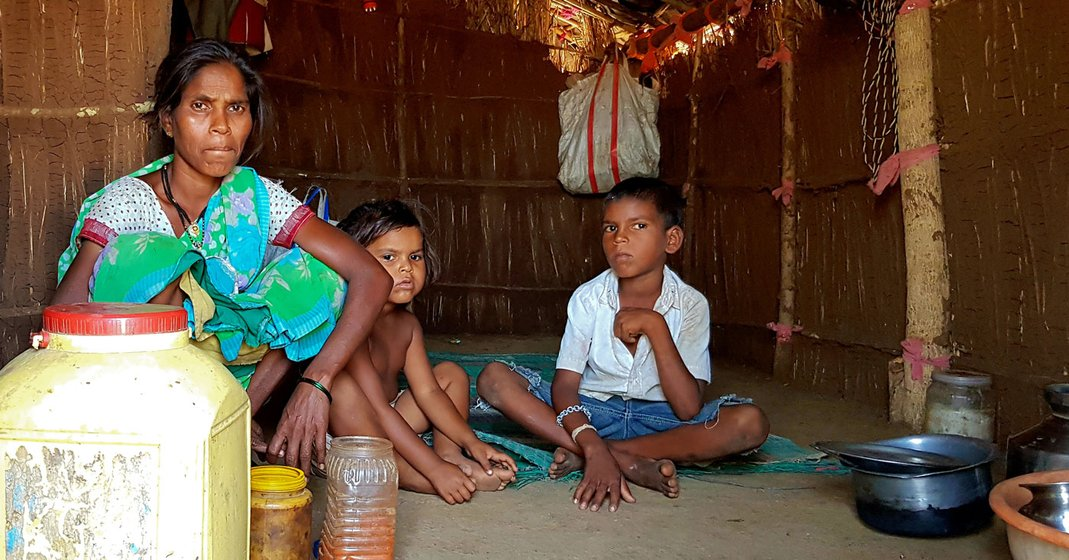Vanita Bhoir had a week's stock of food for her family (here with her daughter Sangeeta and son Krishna) in her straw-and-mud hut