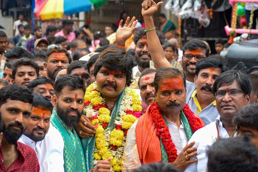 Ashwin and his father Posani Babu coming out of the temple