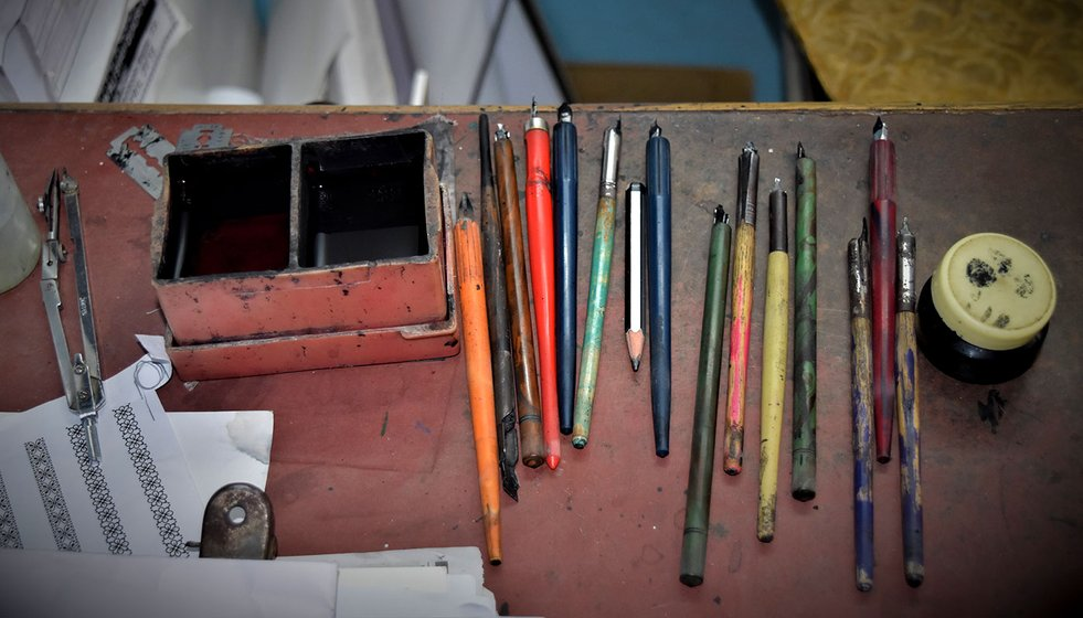 Calligraphy pens lying on the table