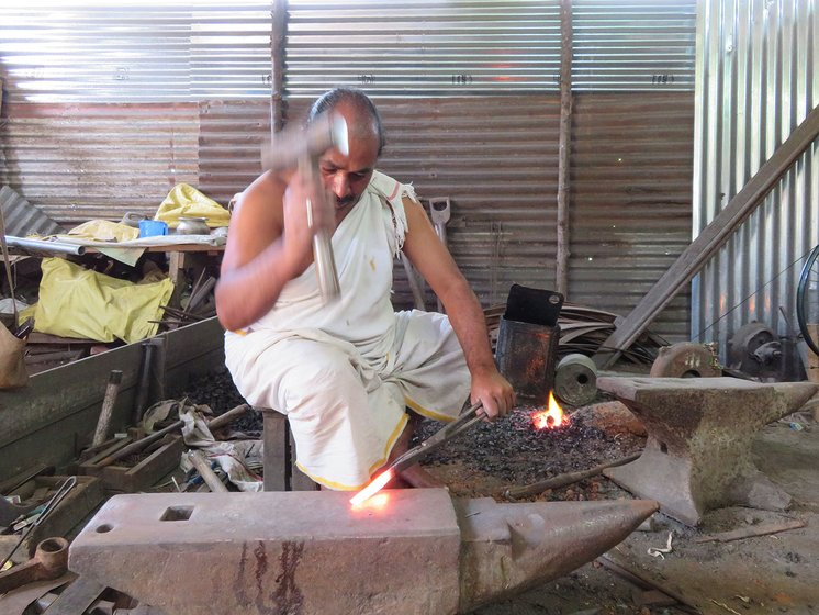 N. Mohana Rangan beating the red hot iron with his hammer
