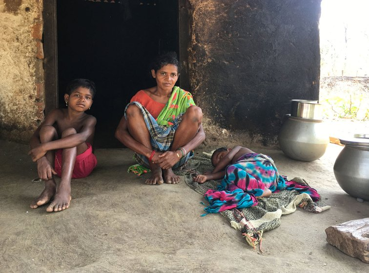 Sukmati with her younger daughter Sarita and infant son; she and Andoram Madkam had eight children; five have died, including Jamlo