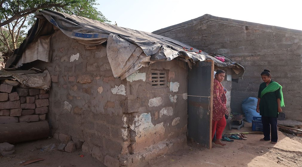 Puja Vaghela's house in Ramnagari slums, Bhuj city, where we met the young women