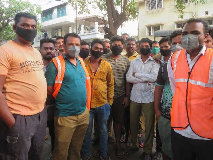 Left: On Saturday, like on all their work days, safai karamcharis gathered at 6 a.m. at the chowki in M-West ward, ready to start another day of cleaning, at great risk to themselves. Right: Among them is Anita Ghotale, who says, 'We got these masks only yesterday [on March 20], that too when we demanded them due to the virus'