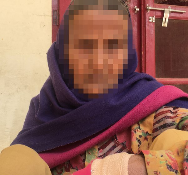 Aarifa: 'Using a contraceptive is considered a crime'; she had sprained her hand when we met. Right: The one-room house where she lives alone in Biwan