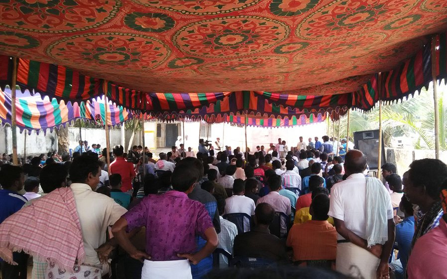 Government officials conducting public hearing in December 2016 which witnessed widespread protests by the villagers