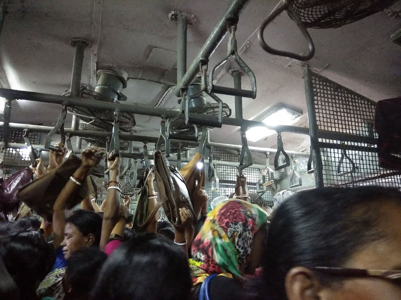 Breshpati Sardar and other women workers on a crowded train from Sealdah to Canning, via Jadavpur