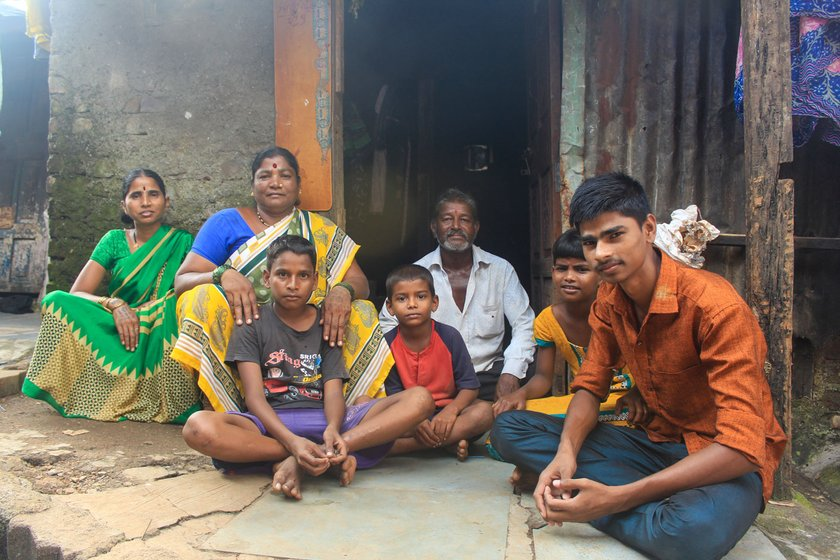 Some of the family members (left to right) –  Sangeeta (Ramdas's wife), Jayshri, grandkids, and Waman (in the doorway). Right: Sukhdev is 'pagal about films' says Jayshri