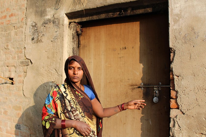 Bhootani Devi (Dharmendra's sister-in-law) in front of the locked door of Dharmendra's house in the village of Dharauta