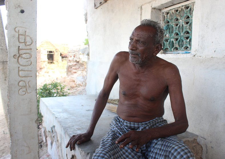 Kandasamy seated on the porch of his house