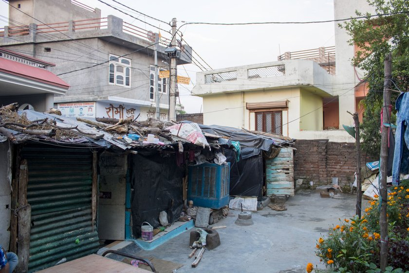People in nearby buildings gave rations to the labourers living in the three rooms (left) in a back lane in Jammu city. Mohan Lal (right) resides in one of the rooms