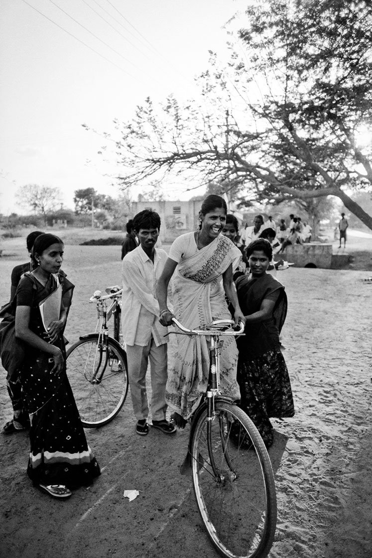 Women learning how to ride bicycles in a village in Tamil Nadu
