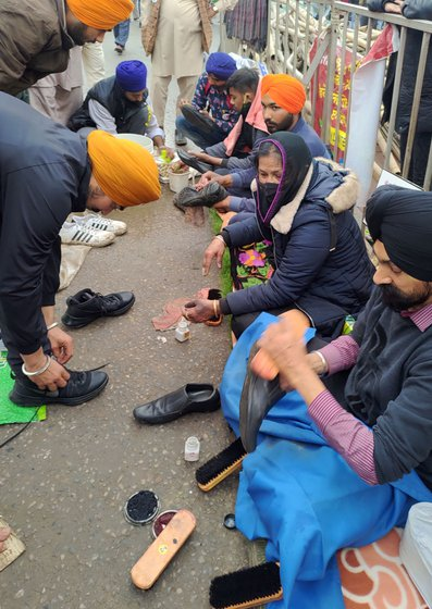 'I cannot usually sit for one hour straight. But once we come here, I clean shoes for six hours and feel no pain while doing so,' says Jaswinder, who suffers from chronic back pain. 'I am a daughter of farmers. I cannot see them in pain. I polish their shoes', says Prakash