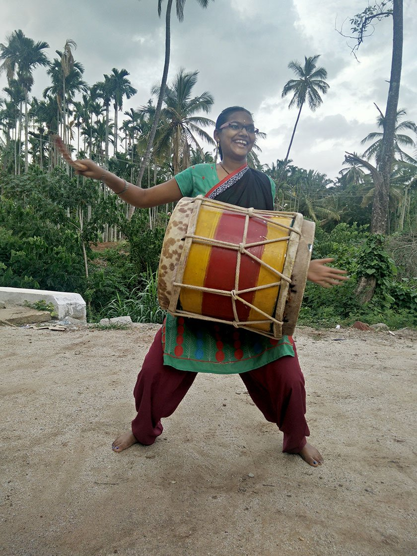 Narsamma playing the dollu kunitha