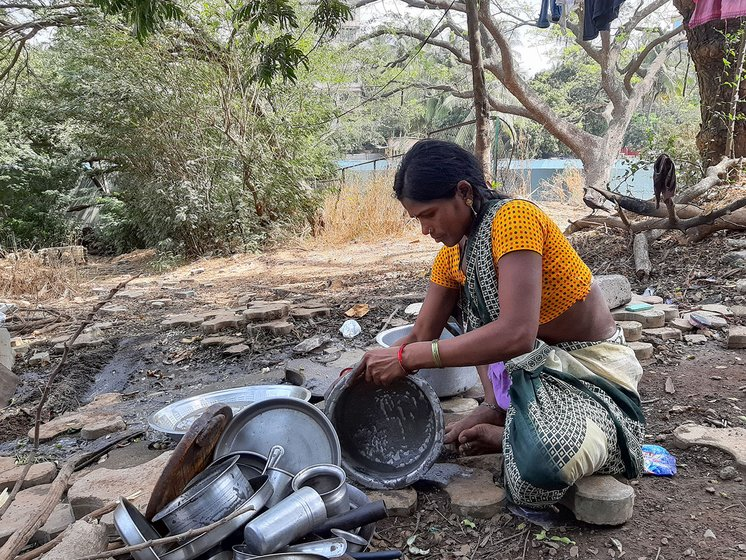 Maya Mohite washing the utensils. This is in the same area where her tent is set up.