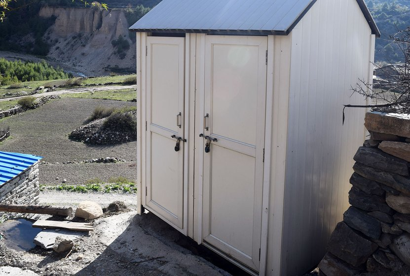 More make-shift toilets at the entrance of the village Gunji