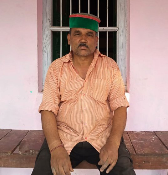 Joban Lal sitting outside his house.