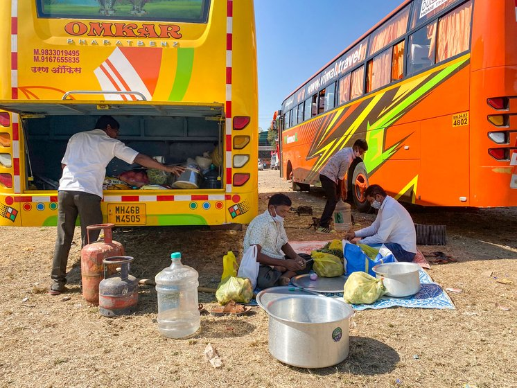 The bus is stacked with onions, potatoes and rice, among other items. When activists leading the march stop, Bhagat and his colleagues get to work