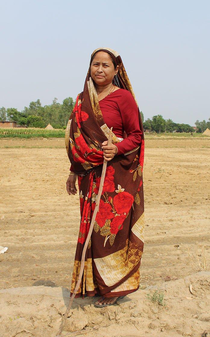 Kamla Devi stands on her farm in the village of Pindari (Udham Singh Nagar), Uttarakhand