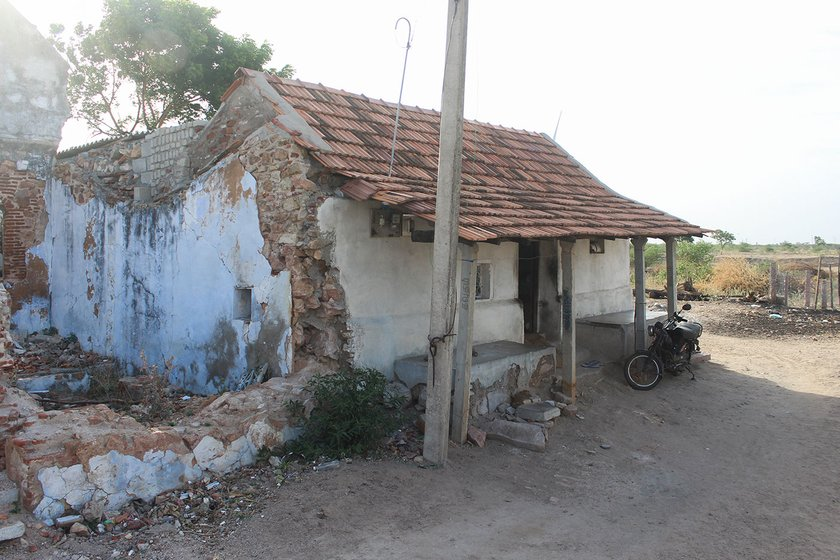 Kandasamy's home with his two wheeler parked in front of it