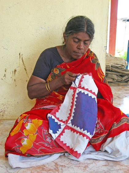 Woman sewing a piece of cloth