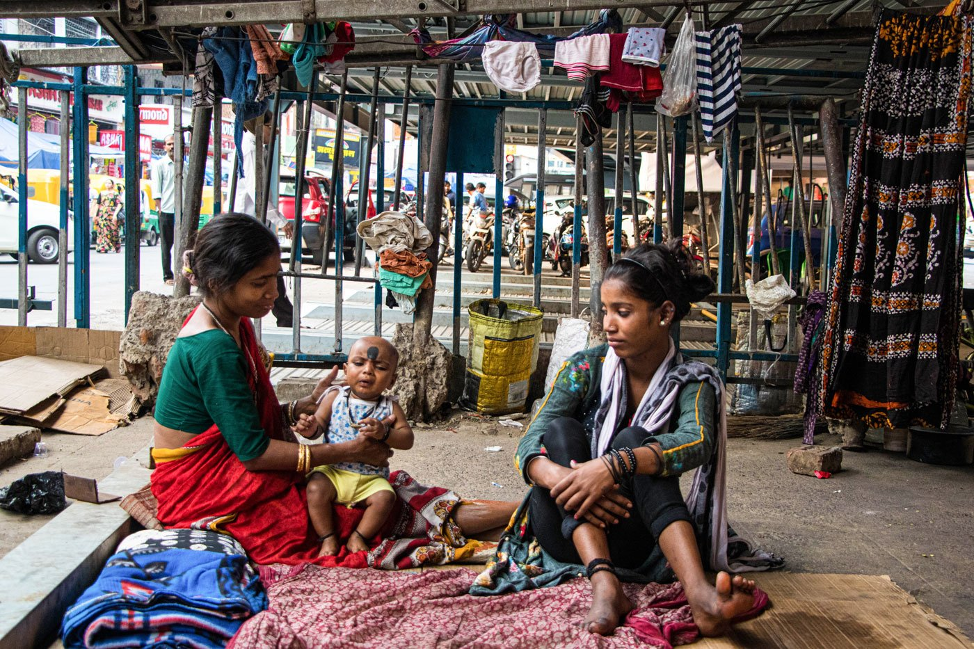 When Cyclone Amphan hit Kolkata on May 20, Sabita (on the left in the right image) huddled under the flyover with her daughter Mampi and grandson