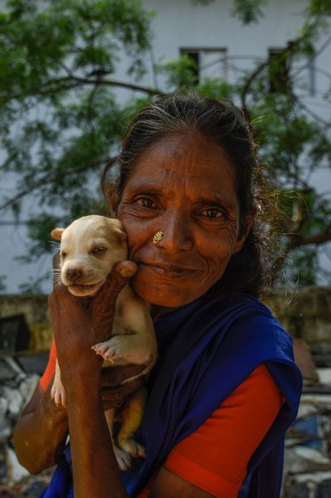 Rita akka cannot speak or hear; she communicates through gestures. Her smiles are brightest when she is with her dogs